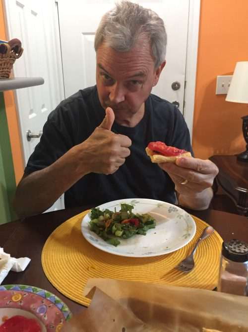 Phil gives the homemade gluten free pizza a thumbs up...