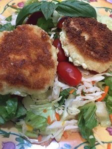 Baked goat cheese medallions on a crisp salad